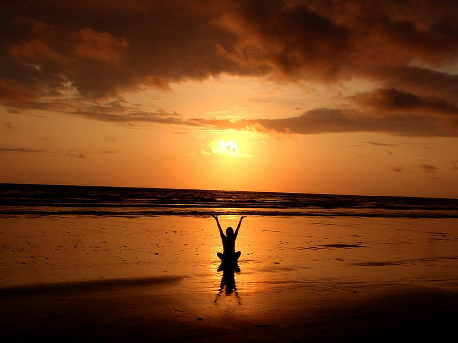 yogaplusexercise.weebly.com yoga plus exercise on the beach.  Solo.  Pose is Sun salute sitting at sunset