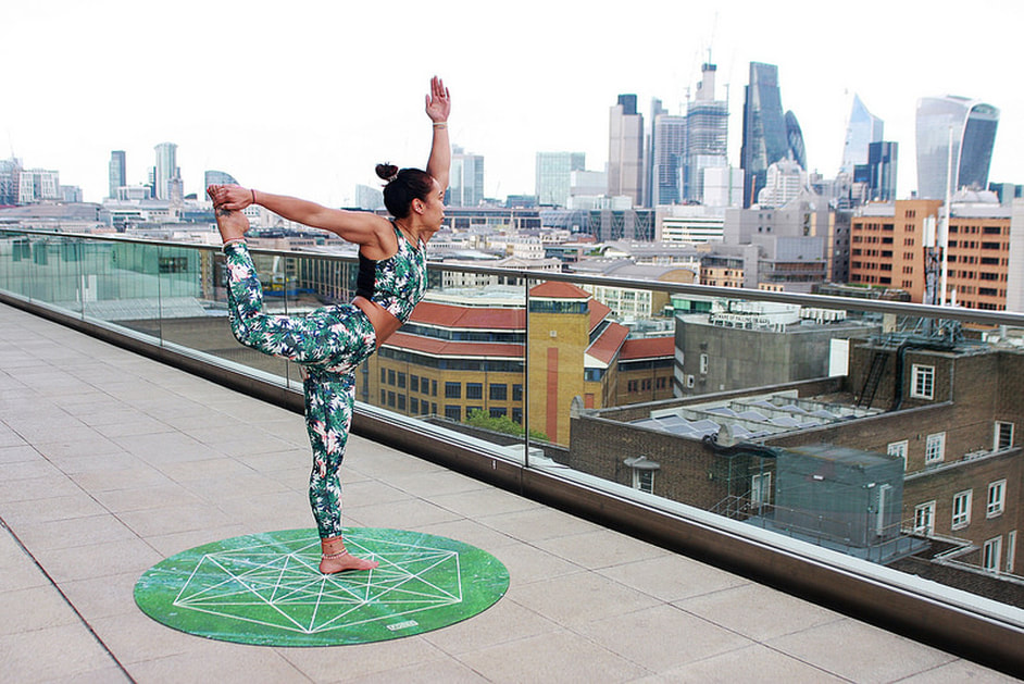 Yoga plus exercise rooftop pose on one leg